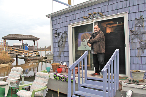 Houseboat owner Michael Evers with his puppy Tallulah. (Credit: Carrie Miller)