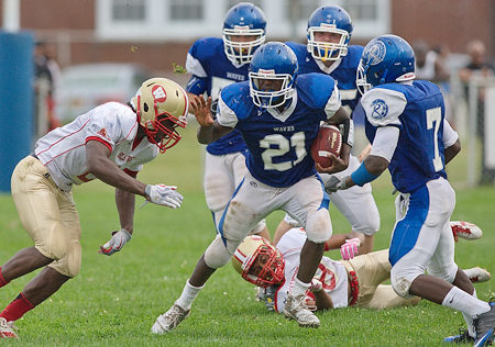 GARRET MEADE PHOTO     RIverhead senior Charles Bartlett scored four touchdowns for the second straight game and had the game-winner at the buzzer.
