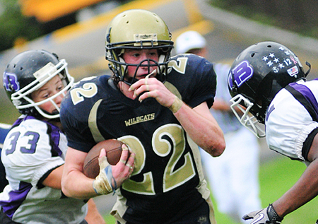 BILL LANDON PHOTO  |  Shoreham-Wading River senior Dylan Bates rushed for 95 yards Saturday against Hampton Bays.