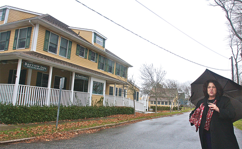 Angela DeVito, president of the South Jamesport Civic Association, outside the Bayview Inn & Restaurant. The group has yet to take an official on a plan to convert the building to apartments, and split the parcel into two separate lots. (Credit: Barbaraellen Koch)