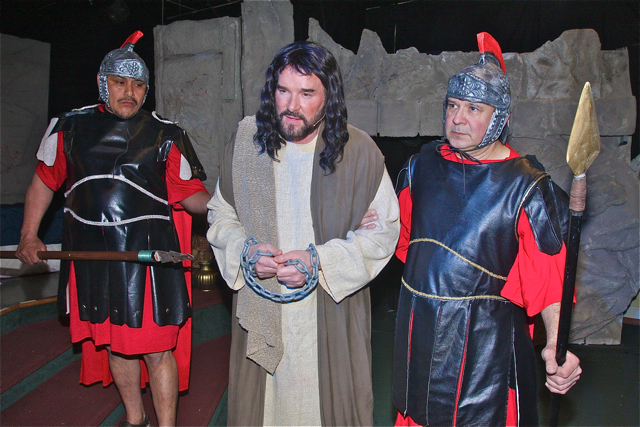 John Dillon (center) as Jesus and the Roman guards Mario Sequen (left) and Roger Roldan. (Credit: Barbaraellen Koch)