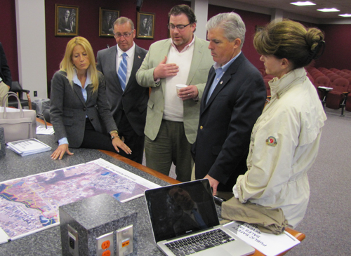 County Executive Steve Bellone, second from right, discusses Southampton Town's Riverside plans with, from left, Councilwoman Christine Scalera, Councilman Brad Benter, Sean McLean of Renaissance Downtowns, and Southampton Supervisor Anna Throne-Holst. (Credit: Tim Gannon)