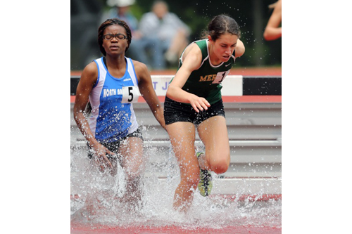 Bishop McGann-Mercy's Delina Auciello makes a splash as the top Division II finisher in the 2,000-meter steeplechase. She was 12th overall in 7 minutes 41.59 seconds. (Credit: Daniel De Mato)