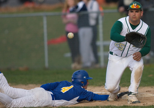 GARRET MEADE PHOTO | Mattituck's Will Gildersleeve diving safely back to first base while Bishop McGann-Mercy's Christian Lynch awaited the attempted pickoff throw.