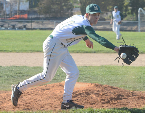 ROBERT O'ROURK PHOTO | Bishop McGann-Mercy's starting pitcher, Kevin Thomas, came off the mound to handle a ground ball.