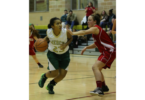 DANIEL DE MATO PHOTO | Bishop McGann-Mercy's Juliana Cintron-Leonardo driving against Southold/Greenport's Kathleen Tuthill.