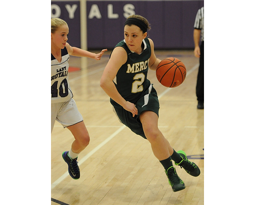 ROBERT O'ROURK FILE PHOTO | Kayla Schroeher of Bishop McGann-Mercy charging toward the basket while Port Jefferson's Jillian Colucci tries to stop her.