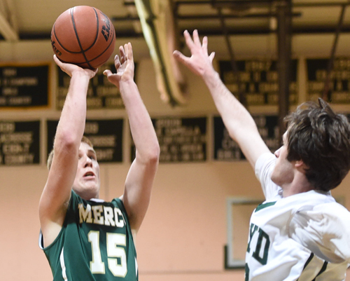 Mike Chiliki of Bishop McGann-Mercy putting up a successful jump shot against William Floyd in the first round of the Colonial Classic. (Credit: Robert O'Rourk)