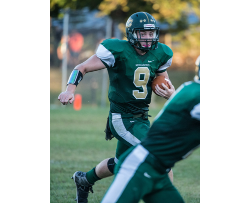 Bishop McGann-Mercy quarterback Kevin Santacroce looks for running room against Elwood/John Glenn's defense. (Credit: Robert O'Rourk)