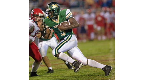GARRET MEADE PHOTO | Reggie Archer, who ran for 116 yards, scored Bishop McGann-Mercy's first touchdown of the season.