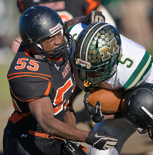 GARRET MEADE FILE PHOTO | Bishop McGann-Mercy's Reggie Archer, right, runs into Babylon's Andrew Watson in a 2012 game.