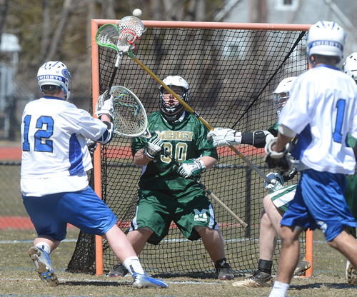 ROBERT O'ROURK PHOTO | Eddie Knight, who started in goal for Bishop McGann-Mercy, facing a shot by Elwood/John Glenn.