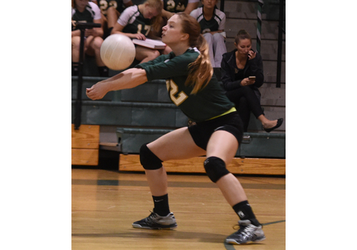Bishop McGann-Mercy's Kate Sorich returns a serve against William Floyd. (Credit: Robert O'Rourk)