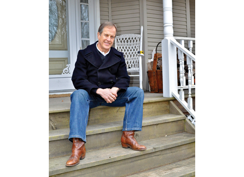 TIM KELLY PHOTO | Greg Blass on the front porch of his Jamesport home last week.