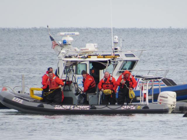 A search and rescue boat from the Rocky Point Fire Department and a Suffolk County marine boat in Long Island Sound Sunday. (Credit: courtesy of Emily Espenkotter)