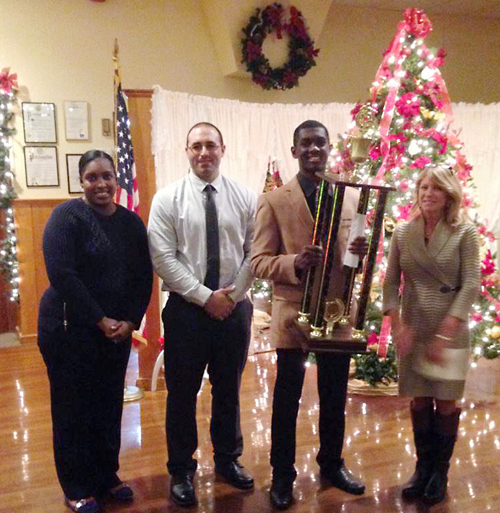 McGann-Mercy senior Reggie Archer received the 2014 Boden Award Dec. 5. He's pictured with his mother (left), football coach Phil Lombardi and Denise Boden. (Courtesy photo)