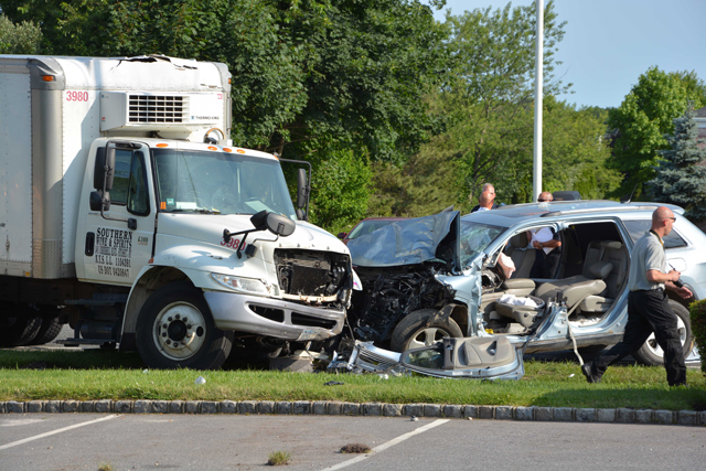 Police investigate the scene of the crash. (Credit: AJ Ryan, Stringer News Service)