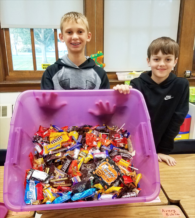 Ben Grodski, left, and James Gallo, collected about 40 pounds of candy. (Credit: Riverhead Schools)