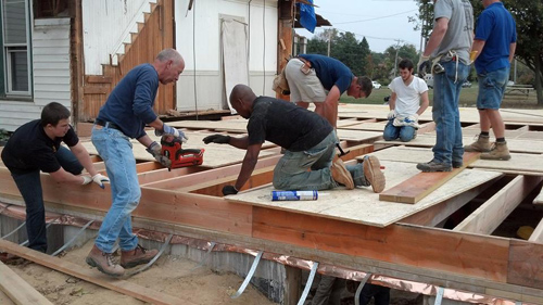 NEW BEGINNINGS COURTESY PHOTO | Volunteers helping frame the first floor of New Beginning Brendan House on Sound Avenue.