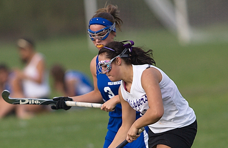 GARRET MEADE PHOTO  |  Greenport's Jackie Esposito moves the ball up field against Riverhead's Christy Brewer, who scored the game-winning goal in penalty strokes after the game ended scoreless.