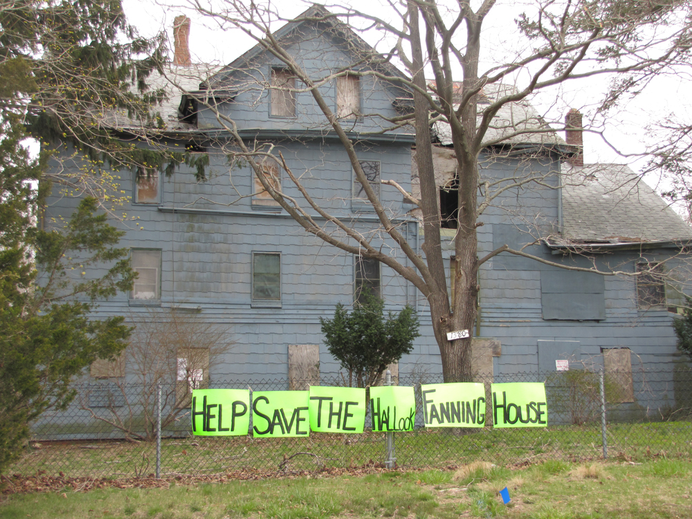 Supporters of the Hallock Fanning house on Flanders Road recently placed these signs on the property. (Credit: Tim Gannon)