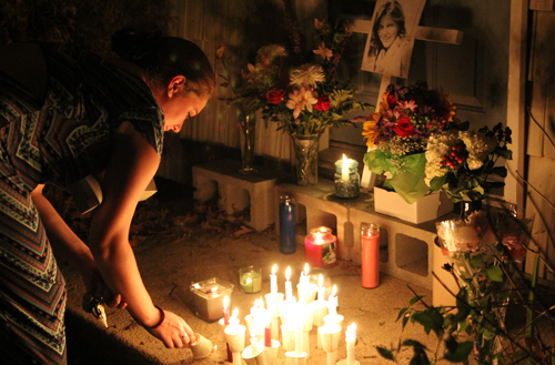 Brittany Rocco lights a candle at a memorial for Amy (Credit: Jen Nuzzo)