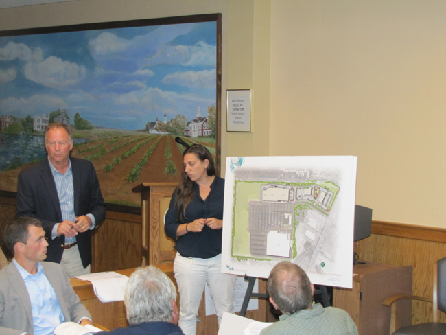 Bill Greimel of Brixmor and counsultant Courtney Riley discuss their new plans for the Costco shopping center Thursday.