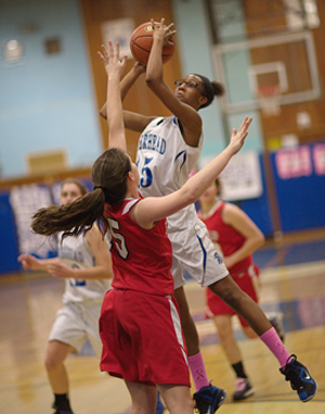 GARRET MEADE PHOTO  |  Riverhead freshman Dezare Brown goes up for a shot.