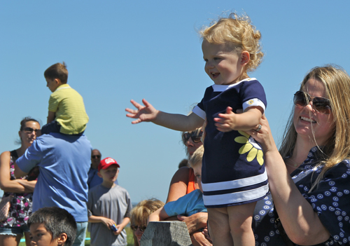 CARRIE MILLER PHOTO | 18-month-old Julianna Elefonte cheers on as the ducks near the finish line.