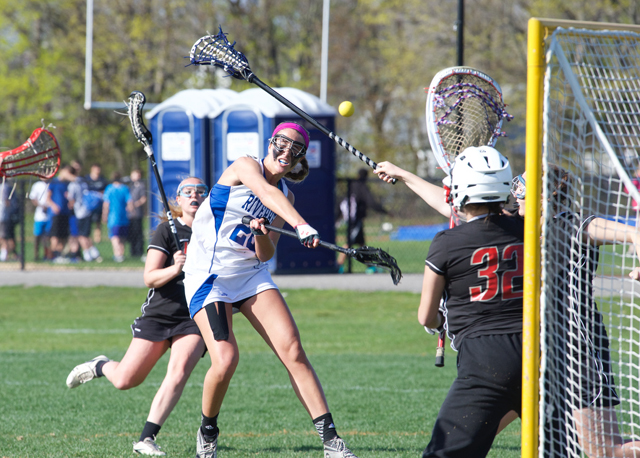 Riverhead junior Courtney Troyan fires a shot toward the cage Thursday. (Credit: Robert O'Rourk)