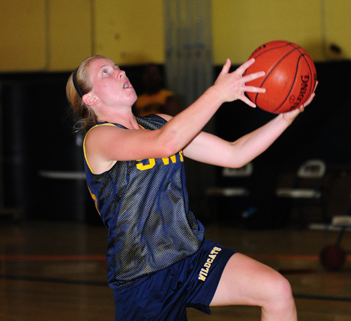 Shoreham-Wading River guard Caitlin Mirabell goes up for a layup against Bayport-Blue Point Monday night. (Credit: Bill Landon)