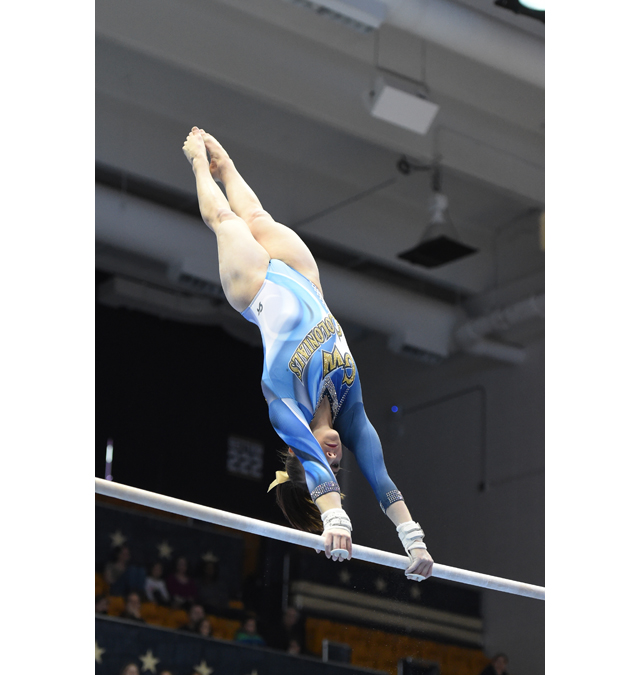 Cami Drouin-Allaire competes in the bars. (Credit: GW Athletics Communications)