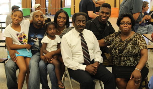 Retiring Pulaski Street School head custodian Carl James, front, with his family at a June 24 school board meeting. (Credit: Jennifer Gustavson photos)