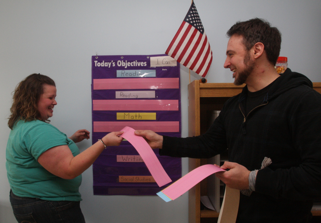 Integrated first grade co-teachers Lindsay Davis and Anthony Dohrenwend set up a teaching objectives display in their classroom Monday afternoon. (Credit: Barbaraellen Koch)