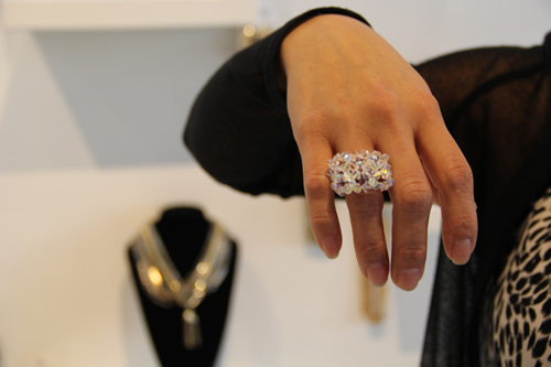 CARRIE MILLER PHOTO  |  Wendy Martinez shows off a piece of piece of custom-made jewelry.
