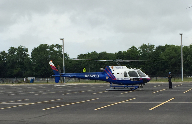A police helicopter landed at Riverhead High School to transport the victim. (Credit: Lauren Lustgarten)