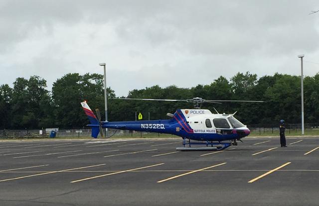 A police helicopter landed at Riverhead High School to transport the victim. (Credit: Lauren Lustgarten)