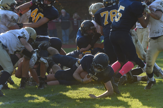 Shoreham-Wading River junior Chris Rosati crosses the goal line for the Wildcats' final touchdown Saturday. (Credit: Robert O'Rourk)