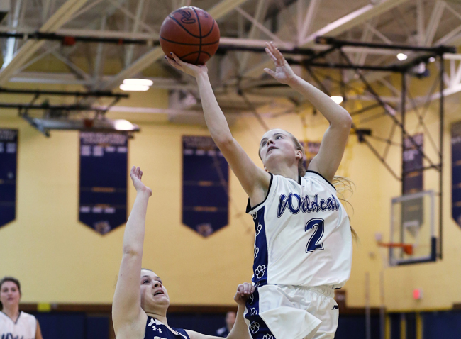 Shoreham-Wading River senior Courtney Clasen scored 24 points in the Wildcats' win Tuesday against Bayport-Blue Point. (Credit: Daniel De Mato)