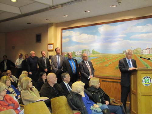 Speakers line up to speak at Wednesday's public hearing on assisted living