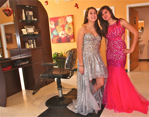 BARBARAELLEN KOCH PHOTO  |  Riverhead High School students Mychala Conti, 15, and sister Rachel, 17, tried on some of the 2013 'Jovani' prom dresses after having their hair styled. They said that their mom thought it would be a fun outing for them.