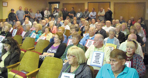 TIM GANNON PHOTO | Angry residents of Foxwood Village and Millbrook Community filled the meeting room during the Riverhead Planning Board's special meeting on The Shops of Riverhead Tuesday.