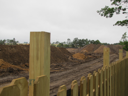 TIM GANNON FILE PHOTO  |  The fence that runs along Foxwood Village and the Shops at Riverhead property lines.