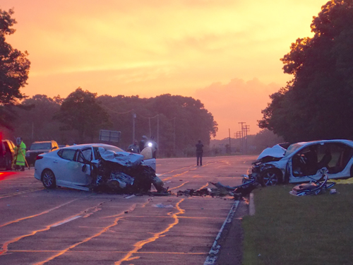 A two-car crash shut down a portion of Route 25 in Calverton Tuesday night. (Credit: Joseph Pinciaro)