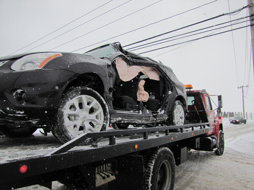 A Nissan SUV spun off Sound Avenue Tuesday morning. (Credit: Tim Gannon)