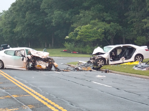 A two-car crash shut down a portion of Route 25 in Calverton Tuesday night. (Credit: Joe Werkmeister)