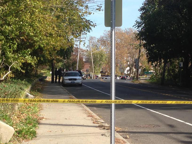A crime scene investigation is underway on the North Side of West Main Street in Riverhead, west of the library. (Credit: Paul Squire)