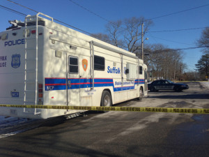 PAUL SQUIRE PHOTO | A mobile command post in front of Demitir Hampton's home on Priscilla Ave. in Flanders, where police say the 21-year-old was shot and killed by armed burglars early Sunday morning.