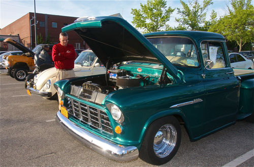 Larry O'Toole of Hampton Bays looks a a 1955 Chevrolet 3100 pickup truck. (Credit: Barbaraellen Koch)