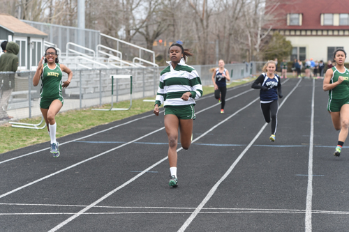 McGann-Mercy senior Danisha Carter cruises across the finish line in the 100-meter dash. (Credit: Robert O'Rourk)